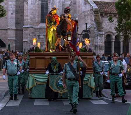 crucis: VALLADOLID, SPAIN – APRIL 18, 2014  Nazarenos and military carrying Jesuschrist sculpture in the religious processions during Holy Week on Good Friday Night, on April 18, 2014 in Valladolid, Spain