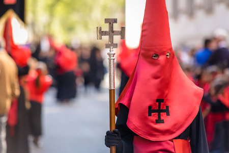 holy thursday: Nazareno carrying a cane with a cross in the Good Thursday during Holy Week in Valladolid