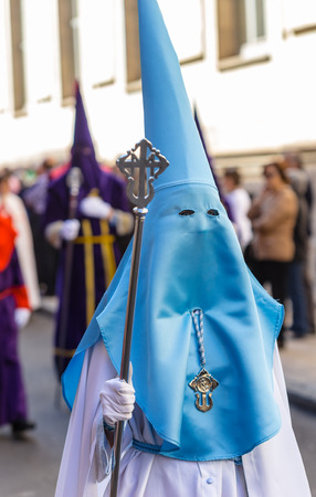 holy thursday: Blue and White nazareno in the Good Thursday during Holy Week in Valladolid