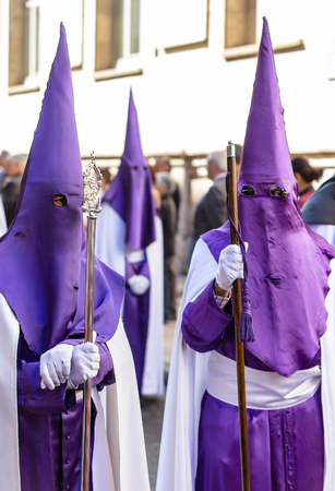 holy thursday: Purple nazarenos in the Good Thursday during Holy Week in Valladolid