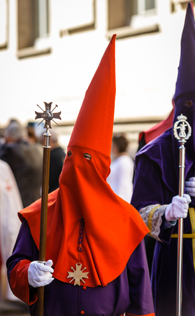 holy thursday: Red and purple nazareno in the Good Thursday during Holy Week in Valladolid