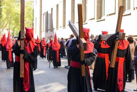 holy thursday: Nazarenos carrying crosses in the Good Thursday during Holy Week in Valladolid