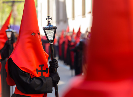 holy thursday: Red nazareno with a lamp in the Good Thursday during Holy Week in Valladolid
