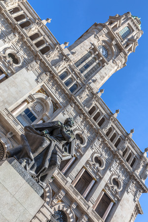 Low angle of the City hall of Porto with the statue of Almeida Garrett. photo