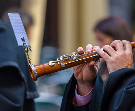 holy thursday: Man playing a typical spanish flute during the Good Thursday during Holy Week in Valladolid. Stock Photo