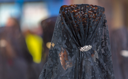 holy thursday: Back side of a woman with a comb in the Good Thursday during Holy Week in Valladolid. Stock Photo
