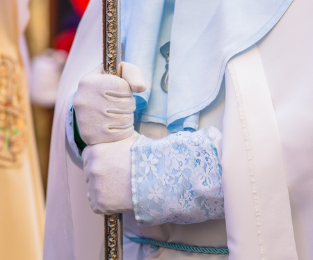 Nazareno holding a cross in his hands in the Good Thursday during Holy Week in Valladolid.