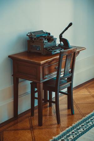 Old typewriter in a wooden desk.