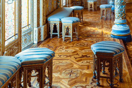 stools: Arabic decorated room with stools and benches.