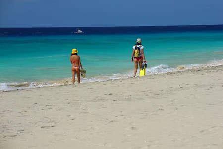 Girls walking on the beach photo