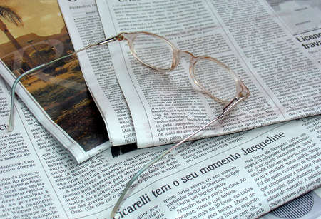 The newspaper and the glasses photo