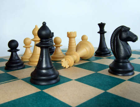 strategize: Chess pieces on the chessboard, with the King dead