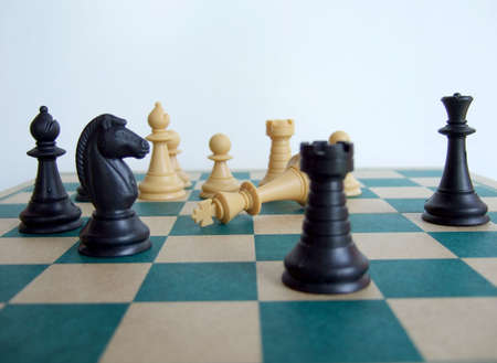 Chess pieces on the chessboard, with the King dead Stock Photo - 875858