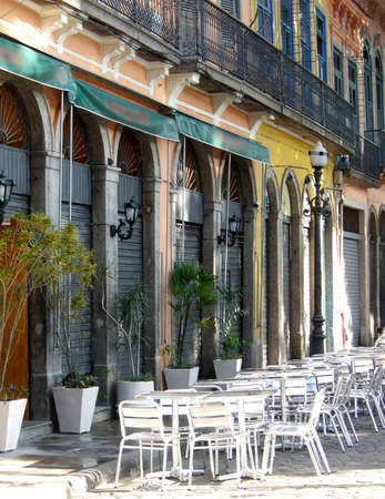 live work city: Colored historical bars with chairs in the sidewalk in Downtown, Rio de Janeiro Stock Photo