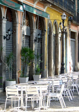 live work city: Colored historical restaurants with chairs in the sidewalk in Downtown, Rio de Janeiro