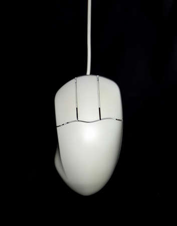 Computer white mouse over a black background photo