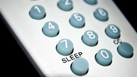 operating key: Remote control sleep button key Stock Photo