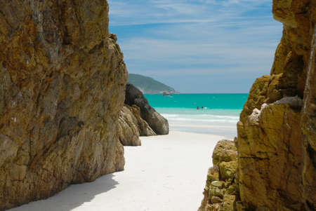 hideout: Cave in the rocks in a Crystalline clear waters in Arraial do Cabo, Rio de Janeiro, Brazil  Stock Photo