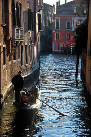 gondolier: Gondolier in the channel in Venice Editorial