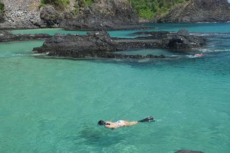 crystalline: Diving in a crystalline sea beach in Fernando de Noronha,Brazil Stock Photo