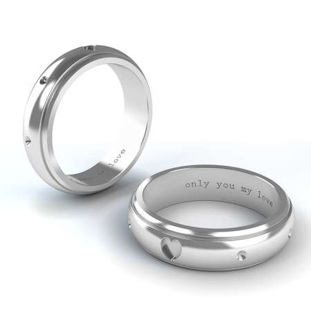 ring wedding: Wedding silver rings isolated on white background Stock Photo