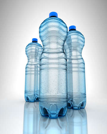 Three bottles of water on reflection surface