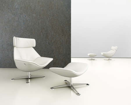 A modern white leather sofa against concrete background on concrete floor Stock Photo