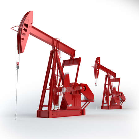 Two Red Oil pumps  Oil industry equipment   Stock Photo