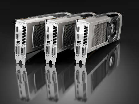 Three Computer graphic cards on black reflective background