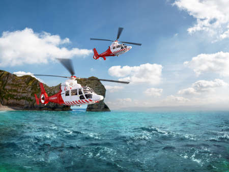 helicopter pilot: Two red rescue helicopter flying in blue sky above the sea