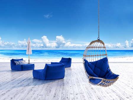 Beach lounge terras met ligbedden parasol en opknoping stoel met uitzicht op zee Stockfoto