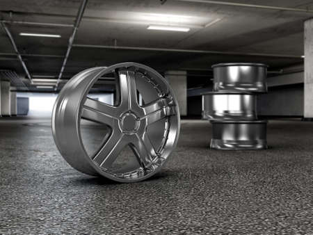 Polished chrome rim wheels in garage