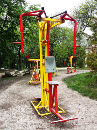 sward: Exercise equipment in public park. Spring day
