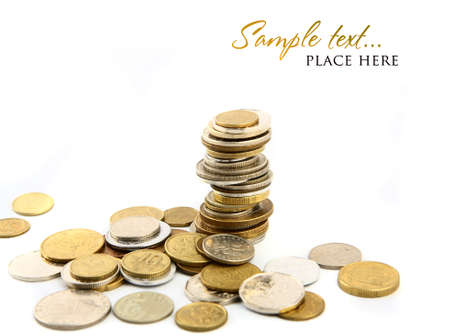 cuve: Heap of coins isolated on white background  shallow DOF