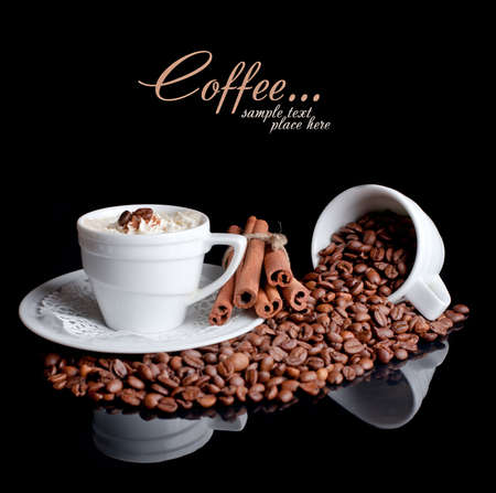 brewed: Coffee background and white cup isolated in black
