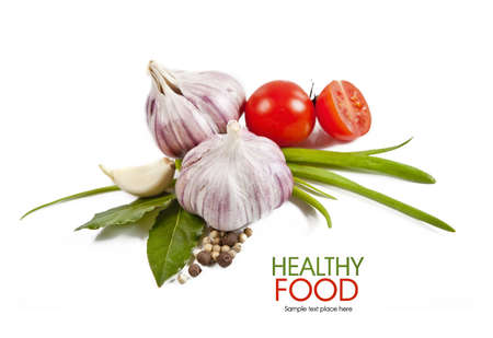 Cherry tomatoes and garlic on white background   Stock Photo