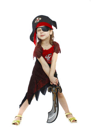 beautiful little girl in a pirate costume isolated photo