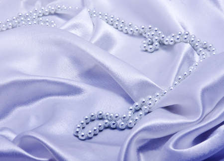 silky: Pearls a necklace on a silk fabric