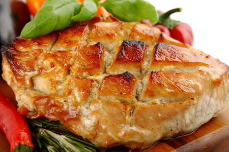 Glazed Roast Pork with vegetables isolated on white background   photo
