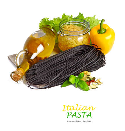 Black pasta with tomatoes isolated in white photo