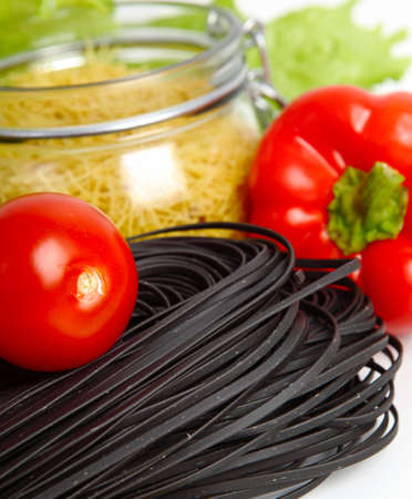 Black pasta with tomatoes isolated in white Stock Photo - 16953920