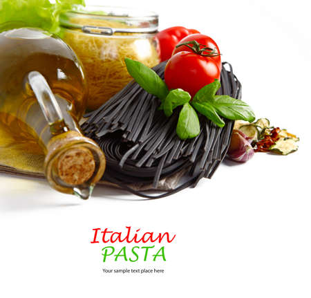 Black pasta with tomatoes isolated in white