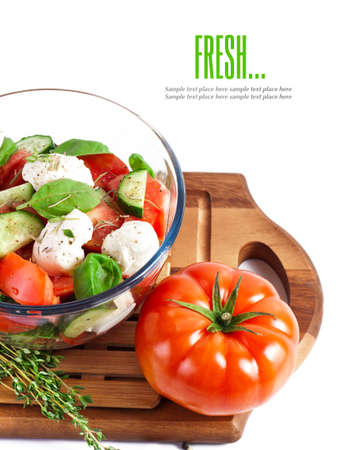 Fresh salad in a stylish white bowl. Isolated on white. photo