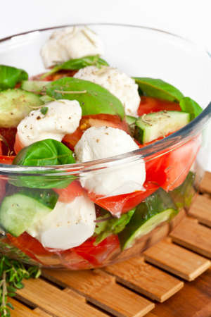 appetiser: Fresh salad in a stylish white bowl. Isolated on white. Stock Photo