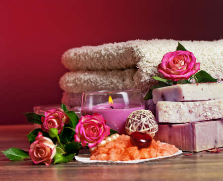 Spa Settings with roses and salt in bowl , towel  Candle,soap on straw mat  photo