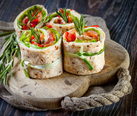 green salad: Salmon lavash rolls with fresh salad leafs