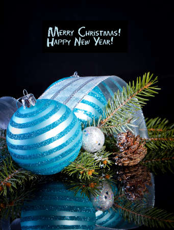 Christmas card with Christmas balls on a dark background photo