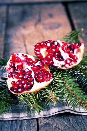 Pomegranate fruit on wooden background