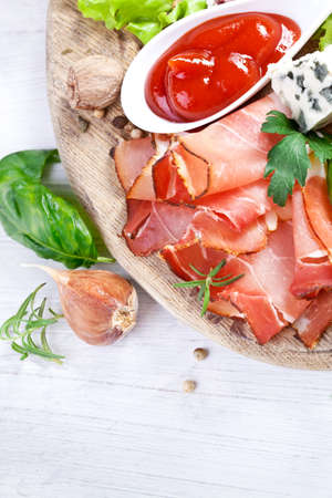 Sliced prosciutto with salami,cheese and basil on a wooden board Stock Photo - 27002536