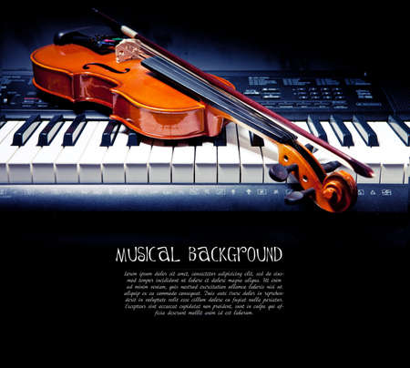 Violin and piano keys on black photo